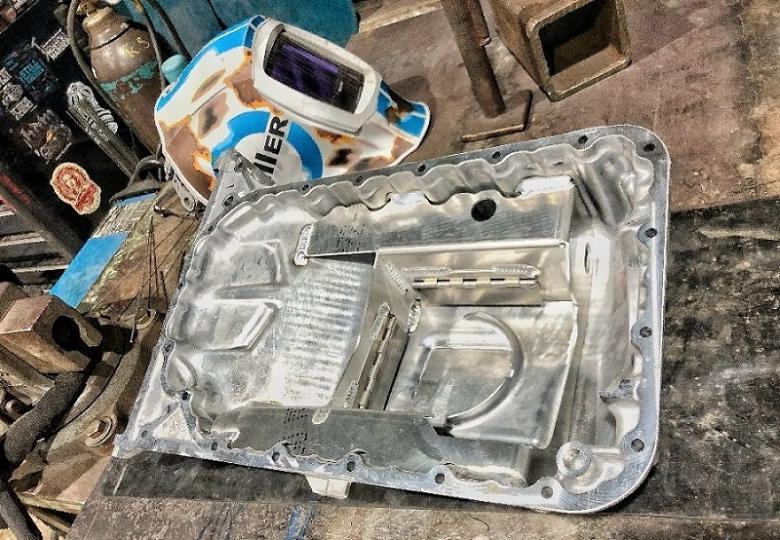 TheFabricator.com: A quick fix, Ill-fitting aluminum baffle on a Honda S2000 oil pan